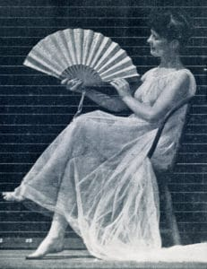 The Human Figure in Motion: Selected single shot of a sitting woman waving a fan